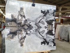 More marble slabs: white, exotic veining, book-matched