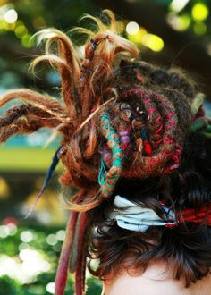 Wrapped dreadlocks by Fogline on Flickr.