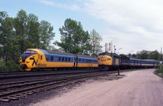 "A cab car trails southbound Ontario Northland No. the ""Northlander,"" into Washago, ON on May 1980 as northbound VIA No. the ""Super Continental,"" departs, led by No. Via Rail, Fashion Background, Railroad Photography, Train Journey, Montreal, Ontario, Airplane, Diesel, Trail"