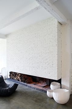 white brick wood burning fireplace - simple, grounding, and unique.