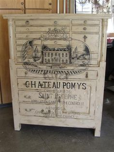 Painted and distressed furniture decoupaged with a vintage French advertisement is an elegant and on-trend way to upcycle an old cabinet. Painting Old Furniture, Furniture Projects, Furniture Making, Furniture Makeover, Painted Furniture, Distressed Furniture, Repurposed Furniture, Shabby Chic Furniture, Vintage Furniture