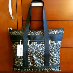 "69✂LeSportsac Cheetah Print Tote2xHP PRICE IS FIRM!! (Seeon TITLE) This is the lowest I can do!! Trying to DOWNSIZE Make me an offer, it's YOURS! ➖➖➖➖➖➖➖➖➖➖➖➖➖  ✨N-W-T✨ Never been used before.   ⏩Exotic cheetah print lends a dose of glamour to lesportsac's signature nylon construction on this spacious, travel-friendly tote.  ⏩Top double zip closure, lined.  ⏩Three exterior zip pockets, one interior zip pocket.   Measurements (approximate) * 19"" x 13""  * 11"" strap drop LeSportsac Bags Totes"