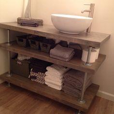 Open concept bathroom vanity. Rustic industrial style. Butcher block and galvanized pipe.