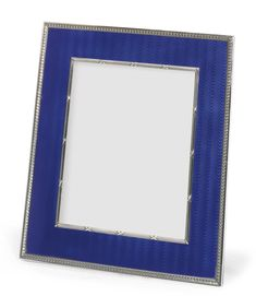 A FABERGÉ SILVER AND TRANSLUCENT ENAMEL PHOTOGRAPH FRAME, WORKMASTER KARL HJALMAR ARMFELT, ST. PETERSBURG, 1908-1917 rectangular, the surface enamelled royal blue over a wavy engine-turned ground within acanthus tip and ribbon-tied reeded borders, the wood back with shaped silver strut, struck with workmaster's initials, K. Fabergé in Cyrillic, and 88 standard, also with British control marks, contained in fitted box of retailer A la Vieille Russie  7 7/8 x 6 7/8 in.; 20 x 17.5 cm