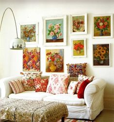 flower paintings over the couch...decorating with art.