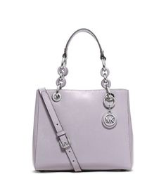 Everlasting luxe. Crafted from sleek patent leather, our sweet Cynthia bag takes a romantic approach to accessorizing. Elegant chain-link top handles and a refined crossbody strap offer a multitude of carrying options, while the practical pockets keep your belongings firmly in place. Let it complement your 9-to-5 favorites with feminine flair.