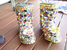 Mosaic Gumboots. I made out of my husband old gumboots, just fill with concrete wait a few days to dry, rip gumboot off let dry again and then start your mosaic..