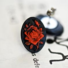 These earrings features Red Rose. These Red Rose cameos are securely attached to nickel free surgical steel posts with butterfly backs (MADE Surgical Steel Earrings, Organza Gift Bags, Red Roses, Cufflinks, Handmade Items, Butterfly, Posts, How To Make, Free