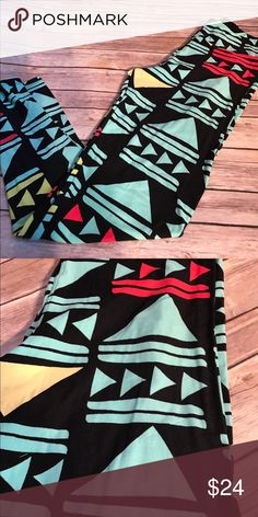 TC LuLaRoe leggings Black background with aqua, red and yellow triangle shapes. Simple and pretty color combination LuLaRoe Pants Leggings