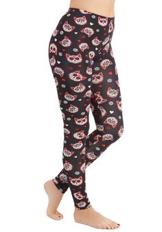 Tenth Life Leggings. Though theyve used up all of their nine lives, the sugar-skull kitties scattered across these black leggings are still just as adorable! #black #modcloth