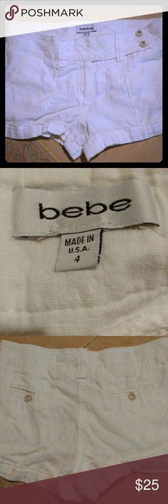bebe white linen shorts Bebe white linen shorts with two buttons, off white on the side. Pockets in the back. Worn few times, almost brand new. bebe Shorts