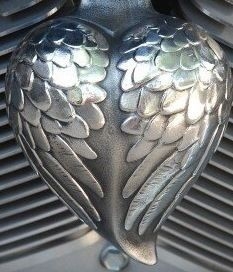 Dennis and John, the guys at Chrome Dome Motorcycle Products, are at it again designing yet another stylish horn cover for Harley-Davidson motorcycles. They say their new Angel Wing horn cover is very popular among women riders, so we're sharing it with you here. Think early holiday gift for you or a friend.