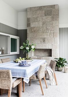 The kitchen windows can be opened to create a servery to the outdoor dining area in this coastal Sydney home. Photography: Maree Homer | Styling: Kayla Gex