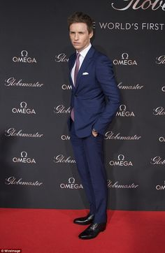 Sharp: Eddie, 34, cut a handsome figure in a slick blue suit teamed with a red spotted tie