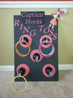 Pirate party captain hooks ring toss. Foam board from the dollar store, hooks from hobby lobby zip tied to the board & pool rings