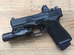 Agency Arms Field Edition Glock 19 with Competition threaded barrel, AAC Ti-Rant 9S, Trijicon RMR, Surefire X400 Light,Trijicon Suppressor Night Sights