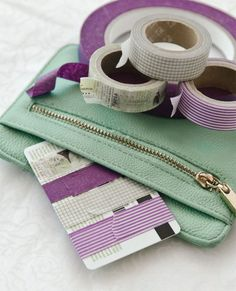 You never know when you'll need a bit of washi tape! To keep it organized, wrap some around an old gift card.