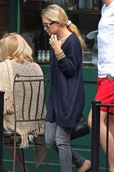 When: June 2012Where: West VillageAfter dining at French hotspot Sant Ambroeus with her sis, Ashley Olsen leaves the restaurant in style: namely, a long blue sweater, grey-wash skinny jeans, and oversized black sunglasses. The standout of her look, though? The throwback white scrunchie that's holding together the perfect low, loose pony. #refinery29 http://www.refinery29.com/olsen-twins-nyc-pictures#slide-10