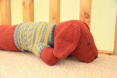 10 weird and wonderful knitting patterns: sausage dog draft excluder by llinda pratt