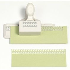 Martha Stewart Crafts Double-Edge Punch, Laurel Leaf Trim.  Use it to make paper ribbons and decorative trim for cards, scrapbook pages, gift bags, table decorations, and much more!