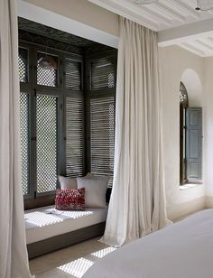 Curtains in antique white to match the walls.