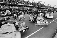 The #3 Holman & Moody Ford GT40 MkIV of Mario Andretti and Lucien Bianchi stands beside the #4 sister car of Denny Hulme and Lloyd Ruby before the start of the World Sportscar Championship 24 Hours of Le Mans race on 10th June 1967 at the Circuit de la Sarthe, Le Mans, France.