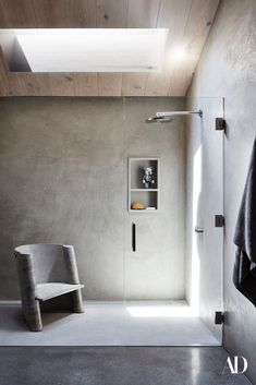 """We created a Pinterest board that was a mile long and full of images of rooms with giant windows, rustic wood, concrete, industrial details, and big, inviting, open spaces."" #grey #concrete #skylight #glass #chair #sparse #decor #modern #wood Bathroom Renovations, Home Renovation, Bathrooms, Laundry Room Bathroom, Minimalist Showers, Interior And Exterior, Interior Design, Step Inside, Architectural Digest"