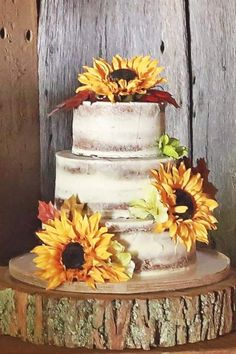 Half naked wedding cake with sunflowers / http://www.himisspuff.com/country-sunflower-wedding-ideas/13/