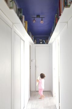 Blue ceiling library on a corridor