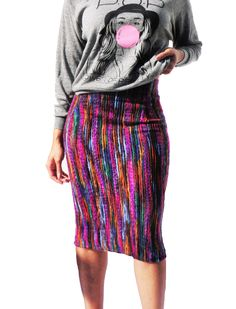 Pencil skirt casual look can be accomplished with a graphic sweater.