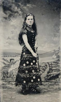 """tuesday-johnson: """" ca. [tintype portrait of a woman in unusual costume, possibly for a Wild West show, with a bow and arrow] """" Vintage Pictures, Old Pictures, Vintage Images, Old Photos, Vintage Postcards, Wild West Costumes, Vintage Cowgirl, Into The West, Pretty Photos"""