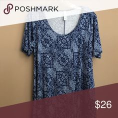 Lularoe Perfect T New, never been worn.  The Lularoe Perfect T runs big.  Tags say S but fits a Med/Large shirt size.  Good stretch!  Flowy bottom. LuLaRoe Tops Blouses