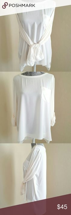 Loft Pocket Blouse NWOT This pretty blouse features a relaxed drapey fit, is semi-sheer, open chest pocket, adjustable roll tab sleeves, and a high low hem. NWOT, never worn. 100% polyester, machine washable. Color is pearl. LOFT Tops Blouses