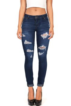 Slim fit stretchy skinny jeans with cuffed ends and distressing across the front. Traditional 5 pockets with a button and zip fly closure. Everyday casual jeans that pair well with fitted cropped or f