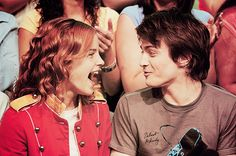i love this picture of dan and emma. and i love how emma laughs!