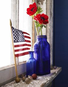 Use blue glassware to display flowers at your 4th of July party.
