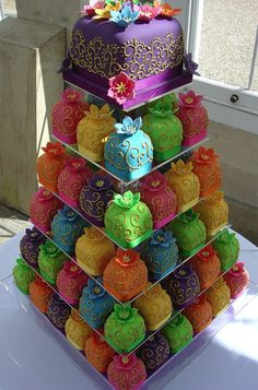 This cake was made by the Rachel Hill of Planet Cake. Beautiful colors and intricate designs cover the mini wedding cakes in six tiers. This unusual wedding cake was made for a couple for their Indian Bollywood wedding.better than cupcakes. Pretty Cakes, Cute Cakes, Beautiful Cakes, Amazing Cakes, Sweet Cakes, Cupcake Tower Wedding, Wedding Cakes With Cupcakes, Decorated Cupcakes, Elegant Cupcakes