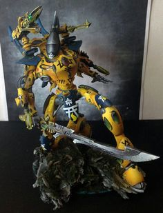 Craftworld Iyanden Wraithtitan. Wargear: shoulder/shuriken-cannon/deathweaver, hand/forearm-wraithglaive & starcannons.