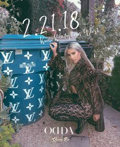 She's the queen! Kim Kardashian posed next to trash cans decorated with the Louis Vuitton ...