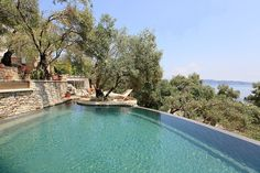 Set within an enchanting olive grove, overlooking the beautiful bay of Agni, the…