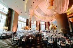 elegant wedding centerpieces   Pale pink uplights and centerpiece pin spots put the finishing touches ...