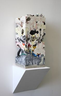 "Jack Henry. Untitled (Core Sample #14), 2012. 20""x9""x9"". Gypsum, cement, acrylic and found objects."