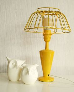 17 Eye-Catching Bedside Reading Lamps All you need: a wire fruit bowl and a lamp base of your choice (you can thrift both). Don't forget the bright yellow spray paint!