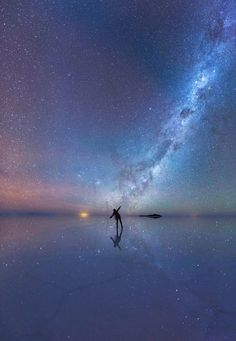 An enthralled stargazer is immersed in the stars as the luminous purple sky is mirrored in the thin sheet of water across the world's largest salt flat, Salar de Uyuni in Bolivia. - Mesmerizing Astronomy Photos Are The Best Of 2015 Photo Univers, Whatsapp Wallpaper, Sky Full Of Stars, Space Photos, Sky Photos, Space Images, Nature Images, Out Of This World, Milky Way