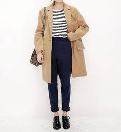 nevy blue pants, white striped top, camel coat jacket