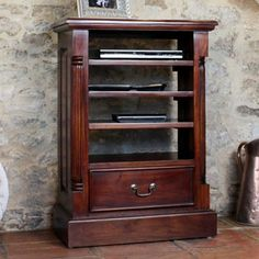 Our elegant La Roque mahogany home entertainment cabinet is designed to house all your media units.