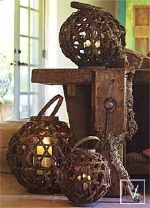 The Big Sur Candleholder Lanterns by Roost  Striking lanterns hand-woven from sliced vine contain glass hurricane inserts.