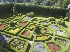 Topiary Hedge and Flower Garden - photo from Whimsical Home and Garden