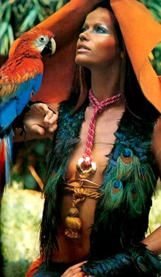 Oh to have the bone structure of a young man plus all the girl bits, a peacock feather vest and a parrot... Veruschka by Franco Rubartelli for Vogue Paris, 1969