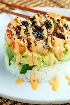 Spicy Shrimp Sushi Stacks Recipe : Spicy shrimp sushi stacks with layers of sushi rice, cucumbers and avocado in addition to the spicy shrimp! Sushi Stacks Recipe, Sushi Roll Recipes, Cooked Sushi Recipes, Seafood Recipes, Cooking Recipes, Onigirazu, Asian Recipes, Healthy Recipes, Spicy Shrimp